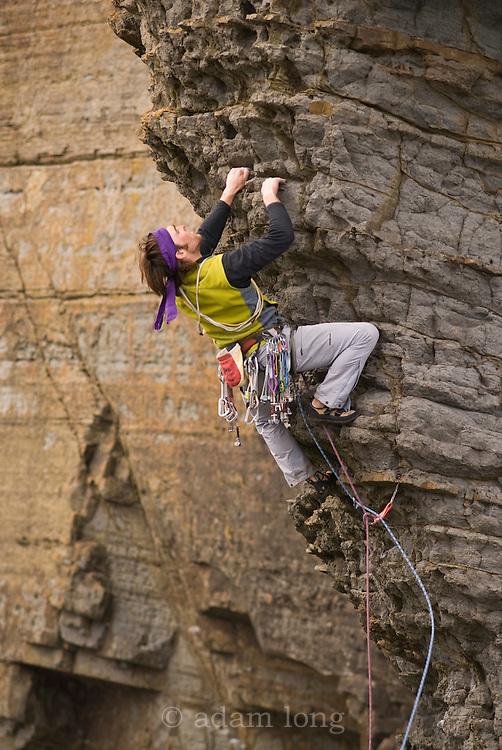 Sean Villanueva O'Driscoll climbing a new route on Craig Doris, Lleyn, Wales