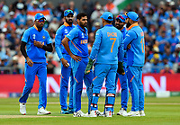 Cricket - 2019 ICC Cricket World Cup - 1st Semi-final - India vs New Zealand<br /> <br /> India's Bhuvneshwar Kumar consults with his team before reviewing an unsuccessful lbw appeal against New Zealand's Martin Guptill at Old Trafford.<br /> <br /> COLORSPORT/ASHLEY WESTERN