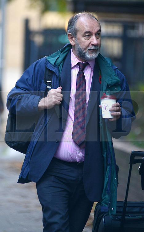 © Licensed to London News Pictures.28/10/2013. London, UK. Derek Richard Osbourne, former Liberal Democrat councillor arrives at the Southwark Crown Court. Derek Richard Osbourne, formerly the leader of Kingston Council is sentenced after pleading guilty, October 1, to five counts of possessing indecent images of children, five counts of distributing indecent images of children and one count of possession of extreme pornography. Photo credit : Peter Kollanyi/LNP