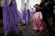 Worshippers dressing angel's costumes celebrate Easter Sunday with a procession in the city of Ouro Preto in the Brazilian state of Minas Gerais,  Sunday, March 31, 2013. (Dado Galdieri)