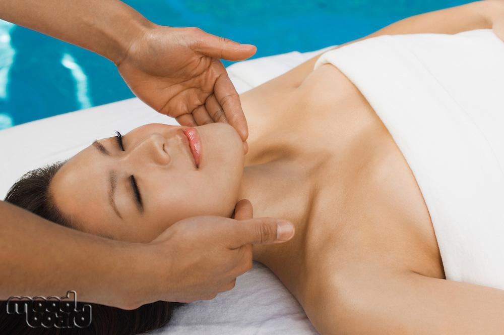 Young woman having massage at health spa