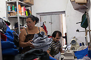 Rosmery sewing in her home in São Paulo, Brazil, where she lives with her husband, seven children and her grandson.<br /> <br /> Rosmery is Bolivian and moved to Brazil in search of work. Prior to moving in to her own home she lived and worked in a sewing workshop with her family, often for up to 16 hours a day. <br /> <br /> Nowadays she still sews and has long days, but she is based from home.<br /> <br /> Rosmery has received a lot of help and support from Missao Paz who work in partnership with C&A Foundation to  offer advice and support on employment, health, family, community and education. <br /> <br /> Their mission is to welcome, understand, integrate and celebrate the lives of immigrants and refugees, dreaming of a universal citizenship.