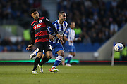 Queens Park Rangers midfielder Massimo Luongo (21) and Brighton central midfielder, Beram Kayal (7) during the Sky Bet Championship match between Brighton and Hove Albion and Queens Park Rangers at the American Express Community Stadium, Brighton and Hove, England on 19 April 2016.