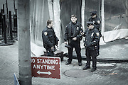 Four NYPD policemen outside the visitor entrance at the NYSE - New York Stock Exchange.
