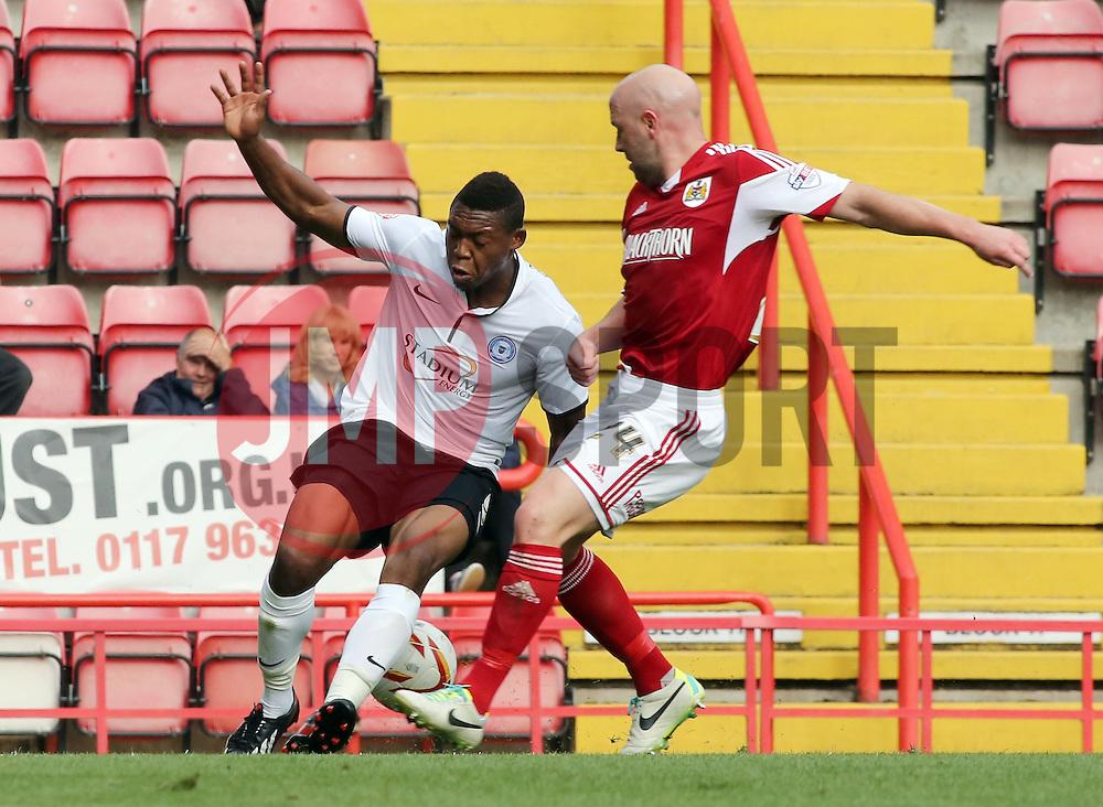 Peterborough United's Britt Assombalonga is fouled by Bristol City's James O'Connor for a penalty  - Photo mandatory by-line: Joe Dent/JMP - Tel: Mobile: 07966 386802 14/09/2013 - SPORT - FOOTBALL -  Ashton Gate - Bristol - Bristol City V Peterborough United - Sky Bet League One