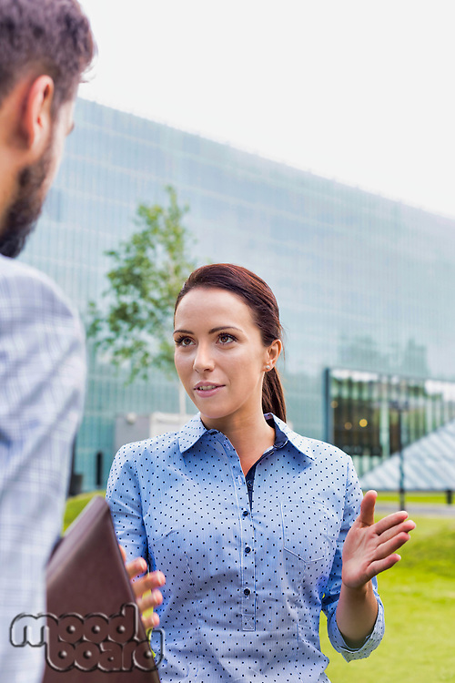 Businessman discussing plans with businesswoman on meeting outdoor