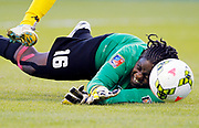 Martinique goalkeeper Cathy Bellune blocks a shot by Jamaica during the first half of a CONCACAF Women's Championship soccer match, Thursday, Oct. 16, 2014, in Kansas City, Kan. (AP Photo/Colin E. Braley)