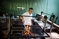 A chef at Papagayo cooks lamb rack over an open flame in District 2, Ho Chi Minh City, Vietnam.