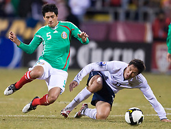 United States forward Brian Ching (11) and Mexico defender Ricardo Osorio (5) battle for possession.  The United States men's soccer team defeated the Mexican national team 2-0 in CONCACAF final group qualifying for the 2010 World Cup at Columbus Crew Stadium in Columbus, Ohio on February 11, 2009.