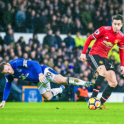 Wayne Rooney of Everton and Ander Herrera of Manchester United challenge for a loose ball during the Premier League match between Everton and Manchester United, Goodison Park, Monday 1st January 2018<br /> (c) John Baguley | SportPix.org.uk