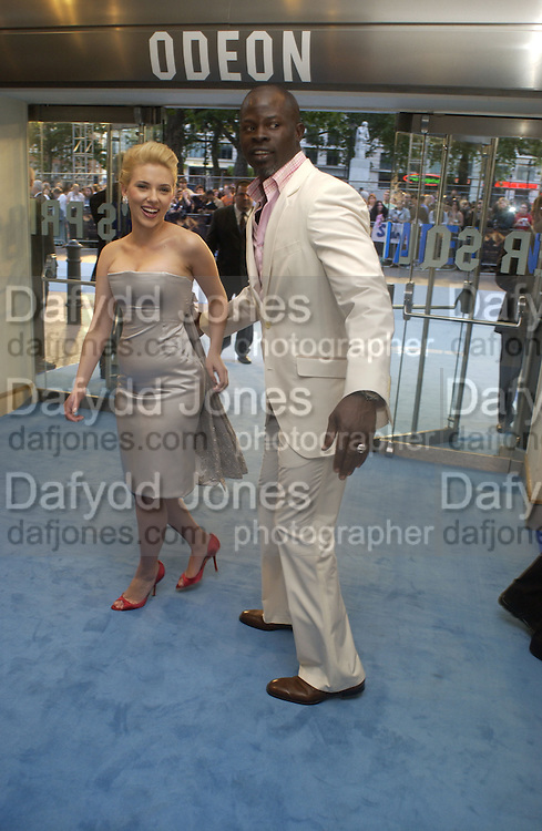 """Scarlett Johansen and Djimon Hounsou. The UK Premiere of """"The Island"""" at the Odeon Leicester Square, London. 7 August 2005. , ONE TIME USE ONLY - DO NOT ARCHIVE  © Copyright Photograph by Dafydd Jones 66 Stockwell Park Rd. London SW9 0DA Tel 020 7733 0108 www.dafjones.com"""