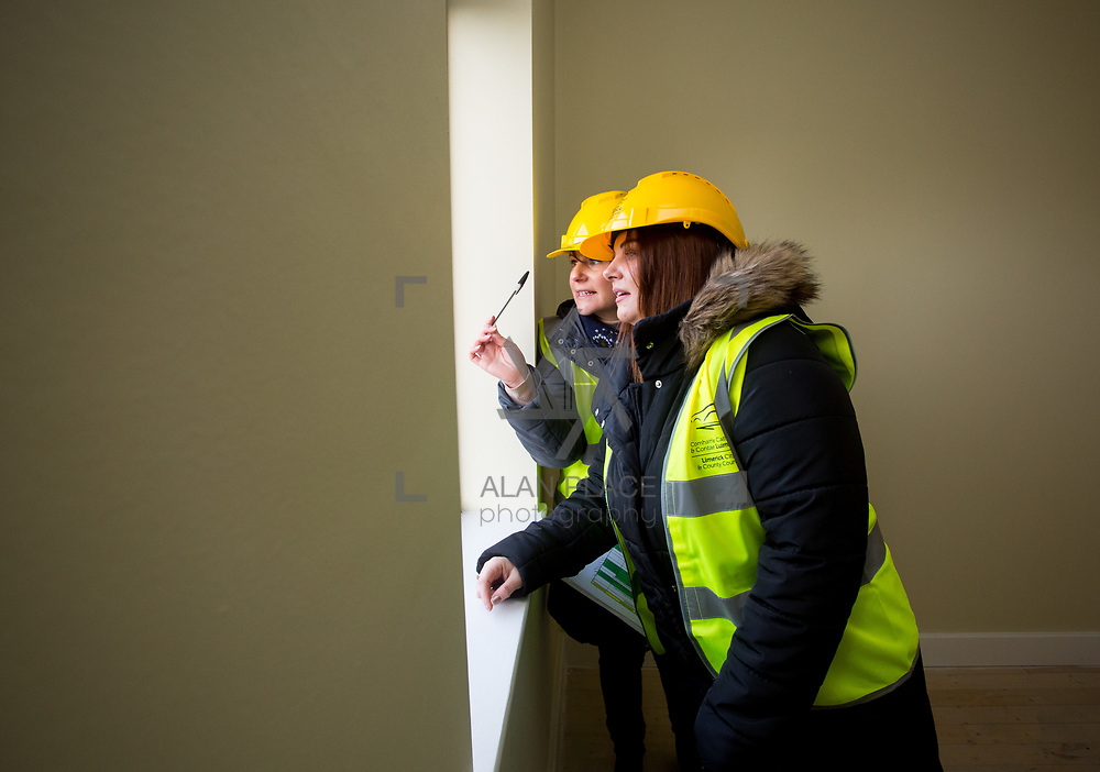 18.12.2017          <br /> Fiona O'keeffe, Limerick City and County Council brings Mary Kelly to view her new home in the development site at the Lord Edward Street Social Housing Scheme. Picture: Alan Place