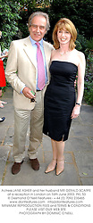 Actress JANE ASHER and her husband MR GERALD SCARFE at a reception in London on 16th June 2003.PKL 53