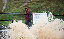 © Licensed to London News Pictures. 25/11/2012..North East England..Heavy overnight rain caused traffic disruption and flooding in parts of Cleveland and North Yorkshire this morning. A water outlet pipe at the beach at Saltburn was overcome with rain water...Photo credit : Ian Forsyth/LNP
