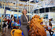 Garden City, New York, USA. March 9, 2019. LAURA CURRAN, the Nassau County Executive, rides Nunley's Carousel carved wood lion during mural unveiling ceremony of Nunley's Carousel horse. Event was held at historic Nunley's Carousel in its Pavilion on Museum Row, Long Island.