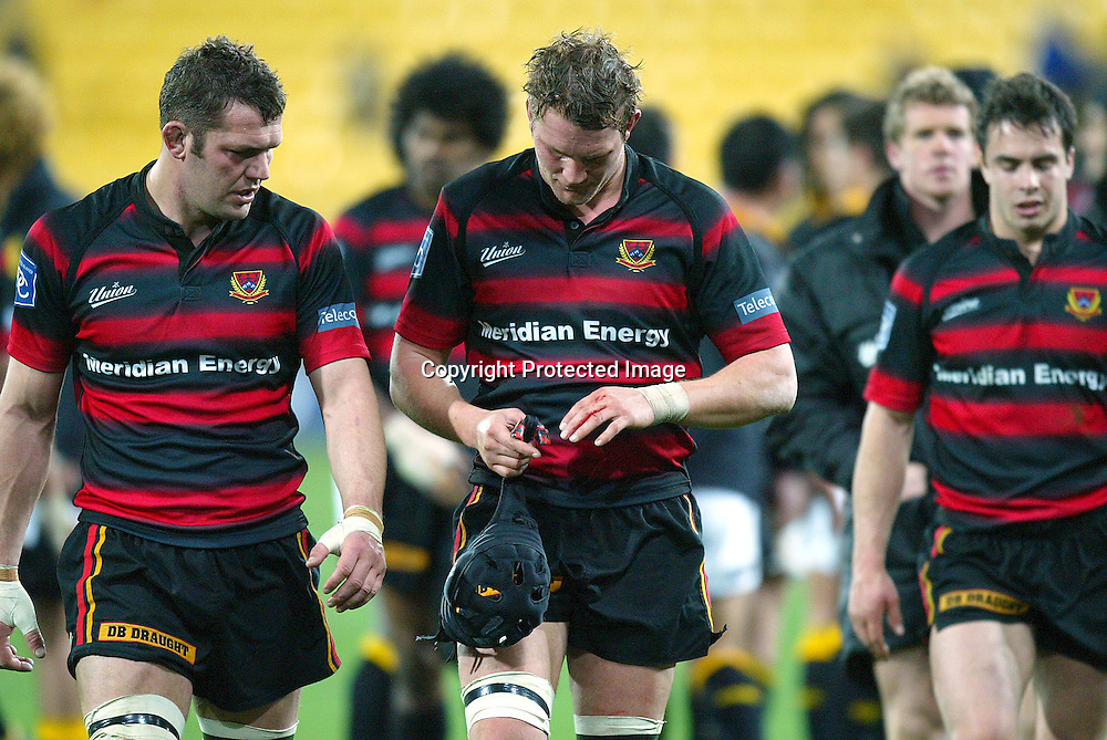 13 August 2004, Westpac Stadium, Wellington, <br /> New Zealand, Rugby Union, NPC Div 1<br /> Wellington Lions vs Canterbury<br /> Canterbury's captain Sam Broomhall with (L) Reuben Thorne walk off the field battered and brused being beaten by Wellington's 34-22 on Friday night.<br /> Please Credit: Marty Melville/Photosport