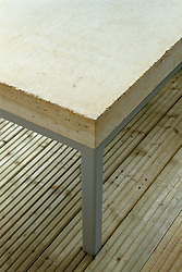 Detail of concrete seat or table on decking