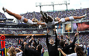 The Baltimore Ravens cheerleaders spin in the air as they perform a leaping dance routine during the NFL week 13 regular season football game against the San Diego Chargers on Sunday, Nov. 30, 2014 in Baltimore. The Chargers won the game 34-33. ©Paul Anthony Spinelli
