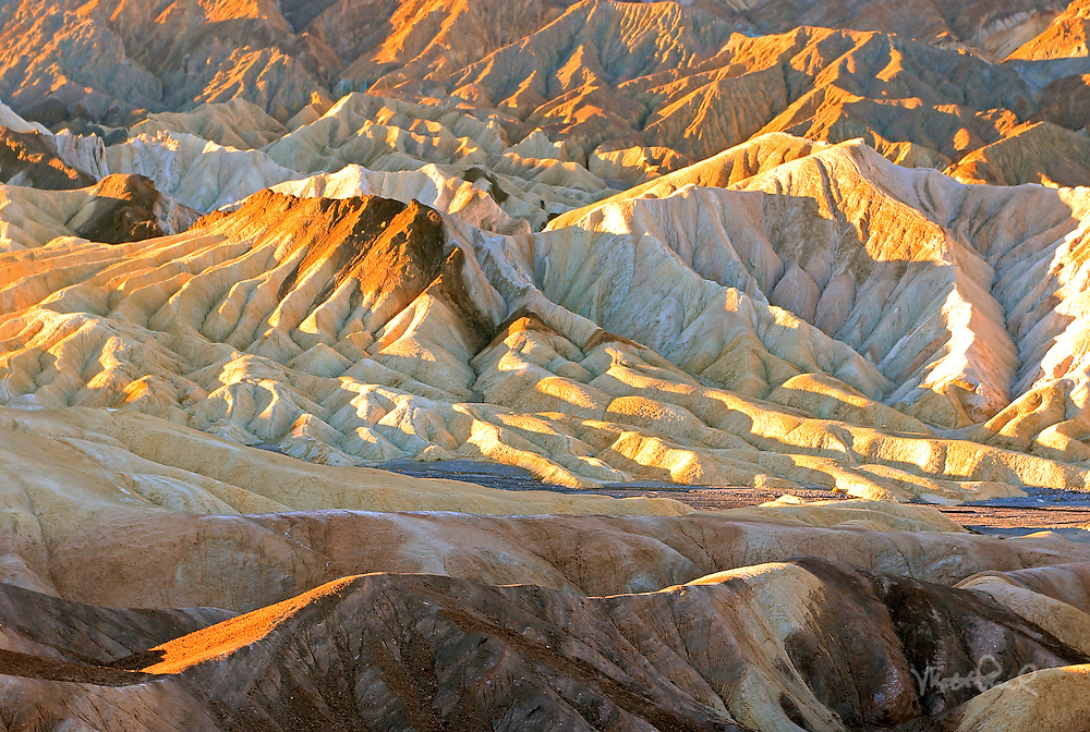 Zabriskie Point Badlands on a warm winter morning. This area of Death Valley is one of my favorite to photograph as the warm light that morning illuminated the mud caked hills.