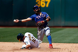 OAKLAND, CA - JULY 28:  Rougned Odor #12 of the Texas Rangers completes a double play over Marcus Semien #10 of the Oakland Athletics during the fifth inning at the RingCentral Coliseum on July 28, 2019 in Oakland, California. The Oakland Athletics defeated the Texas Rangers 6-5. (Photo by Jason O. Watson/Getty Images) *** Local Caption *** Rougned Odor; Marcus Semien