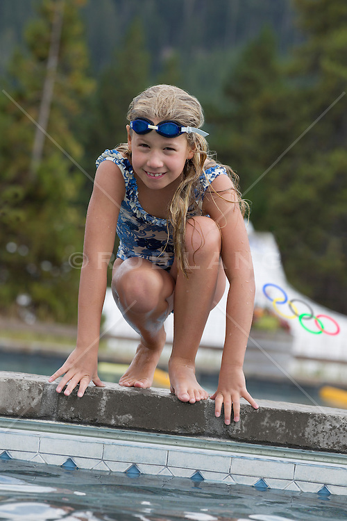 little girl enjoying time by a swimming pool