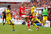 Barnsley midfielder Brad Potts (20) clears the ball ahead of Wimbledon defender Ben Purrington (3), on loan from Rotherham United,  during the EFL Sky Bet League 1 match between Barnsley and AFC Wimbledon at Oakwell, Barnsley, England on 18 August 2018.