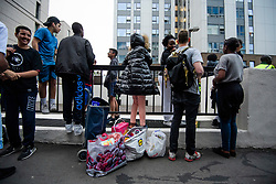 © Licensed to London News Pictures. 23/06/2017. London, UK. Residents wait on the street after being evacuated from the Taplow block of the Chalcots Estate in Camden after it failed a fire inspection because of combustable cladding. Prime Minister Theresa May has told Parliament that up to 600 high rise tower blocks may have similar cladding to that found in Grenfell Tower, which went on fire last week, in which as many as 79 residents are thought to have perished Photo credit: Ben Cawthra/LNP