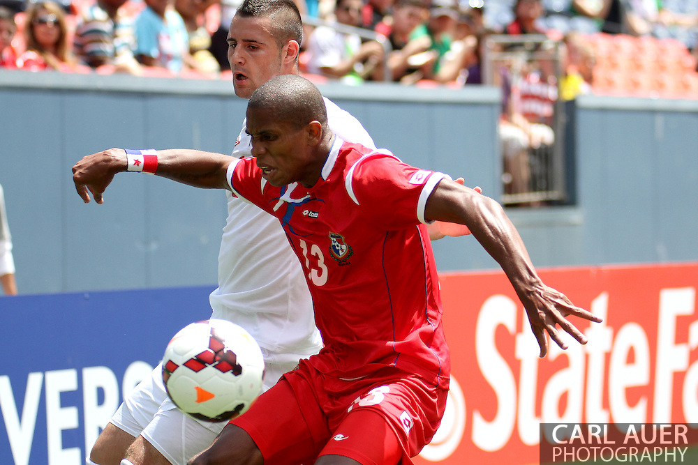 July 14 2013:  Panama Defender Jean Carlos Cedeño (13) keeps the ball from Canada Forward Marcus Haber (11) during the first half of CONCACAF Gold Cup soccer match between Panama and Canada at Sports Authority Field in Denver, CO. USA.
