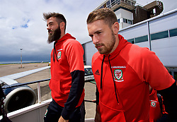 CARDIFF, WALES - Saturday, June 10, 2017: Wales' Joe Ledley and Aaron Ramsey board the team plane as the squad depart Cardiff Tesla Airport to travel to Belgrade ahead of the 2018 FIFA World Cup Qualifying Group D match against Serbia. (Pic by David Rawcliffe/Propaganda)