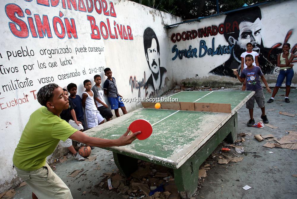 Kids play ping-pong in 23 de Enero, a poor Caracas barrio that his heavily pro-Chavez, on November 29, 2006. (Photo/Scott Dalton)