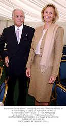 Racehorse owner ROBERT SANGSTER and MRS CAROLYN WATERS, at a race meeting in Surrey on 25th April 2003.	PJD 52