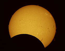 """© Licensed to London News Pictures. 10/05/2013. Sydney, AUS  A solar eclipse on Friday 10th May 2013 in Sydney Australia as the moon glided between Earth and the sun. The celestial spectacle, known as a """"ring of fire"""" eclipse, is the second solar eclipse visible from northern Australia in six months.. Photo credit : Paul Hease/LNP"""