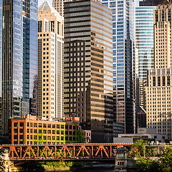 Picture of downtown Chicago buildings at Lake Street Bridge along the Chicago River. Photo is vertical, high resolution and was taken in 2012.