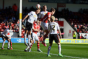 Crewe Alexandra defender George Ray and Crewe Alexandra defender Ben Nugent challenge Walsall striker Tom Bradshaw in the air during the Sky Bet League 1 match between Walsall and Crewe Alexandra at the Banks's Stadium, Walsall, England on 26 September 2015. Photo by Alan Franklin.
