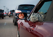 Lt. Savanah Hess, a nurse, waits in her car to enter locked-down Fort Hood military base in Killeen, TX on Wed. April 2, 2014 after an active shooter wounded 14 people.  Hes was trying to get to the hospital on base.  The shooter died on scene.
