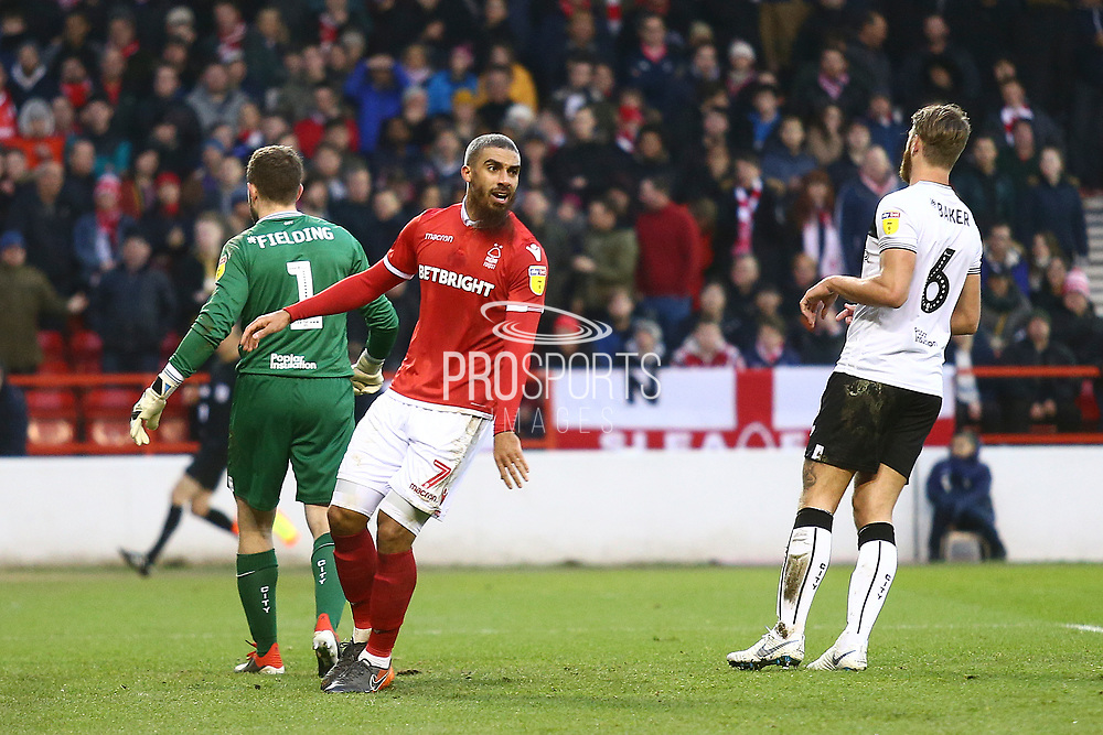 Nottingham Forest forward Lewis Grabban (7) reacts to a missed chance for Forest during the EFL Sky Bet Championship match between Nottingham Forest and Bristol City at the City Ground, Nottingham, England on 19 January 2019.
