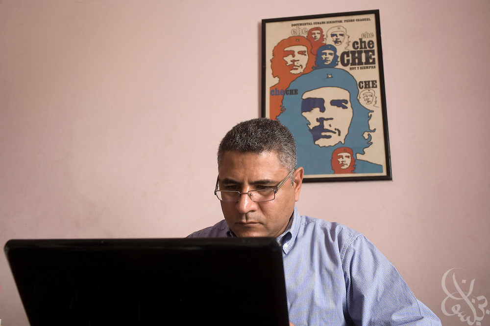Gamal Eid, executive director of the Arabic Network for Human Rights Information works on his computer March 08, 2009 at his office in downtown Cairo, Egypt. Eid works closely advising and representing Egyptian bloggers legally, as many have faced increased political pressure and in some cases even detention, arrest or trial in cases where their writings angered the Egyptian government.