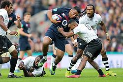 Mako Vunipola of England is challenged by Seru Vularika of Fiji  - Rogan Thomson/JMP - 19/11/2016 - RUGBY UNION - Twickenham Stadium - London, England - England Rugby v Fiji - Old Mutual Wealth Series.
