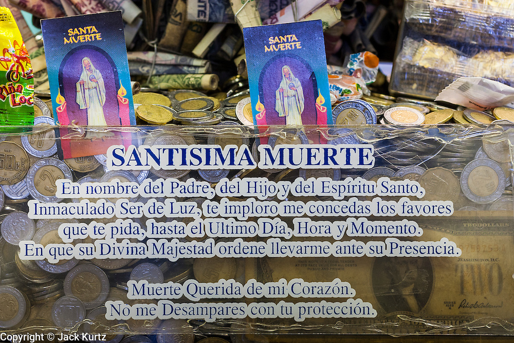 MEXICO CITY, MEXICO:   A donation box for Santa Muerte (St. Death) in a jewelry store in Mexico City. St. Death is venerated throughout Mexico and Mexican communities in the United States. The veneration of St. Death started in Mexico's prisons about 10 years and has since spread through working class neighborhoods in many Mexican cities. The worship St. Death was recognized as an official religion by the Mexican government in 2003. The Catholic Church in Mexico is opposed to the worship of St. Death and has held rallies and prayer vigils against the Saint. The small church in Tepito is frequently swamped with visitors and the religion has spread quickly through the tough, drug and crime plagued neighborhood, widely considered the most lawless in Mexico City. There are about 40 shrines to St. Death throughout Mexico City.       PHOTO BY JACK KURTZ