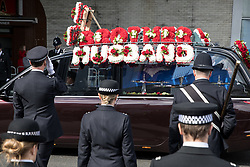 © Licensed to London News Pictures. 10/04/2017. London, UK. The procession leaves following the funeral of PC Keith Palmer at Southwark Cathedral. PC Palmer was stabbed to death at the entrance to Parliament by Khalid Masood on 22 March 2017. Masood also drove a vehicle into people on Westminster bridge, killing four. Photo credit : Tom Nicholson/LNP