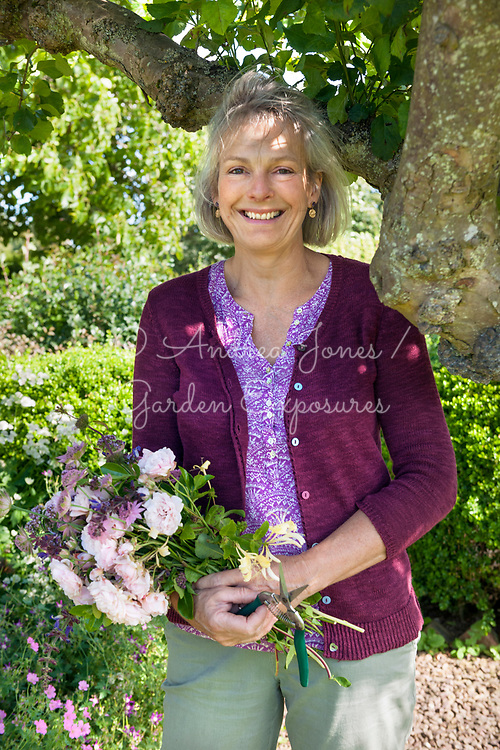 Caroline Straker holding posy of cut flowers.
