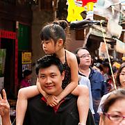"Tourist and daughter in Nine-turns Lane, Lugang's ""old street"", Lugang, Changhua County, Taiwan"