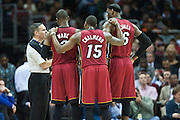 CLEVELAND, OH - MARCH 20: Dwyane Wade #3 Mario Chalmers #15 and LeBron James #6 of the Miami Heat talk to a referee during the first half against the Cleveland Cavaliers at Quicken Loans Arena on March 20, 2013 in Cleveland, Ohio. NOTE TO USER: User expressly acknowledges and agrees that, by downloading and or using this photograph, User is consenting to the terms and conditions of the Getty Images License Agreement. (Photo by Jason Miller/Getty Images)  *** Local Caption *** Dwyane Wade; Mario Chalmers; LeBron James