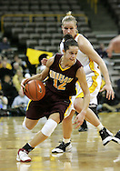 25 JANUARY 2007: Minnesota guard Brittany McCoy (12) drives to the basket in Iowa's 80-78 overtime loss to Minnesota at Carver-Hawkeye Arena in Iowa City, Iowa on January 25, 2007.