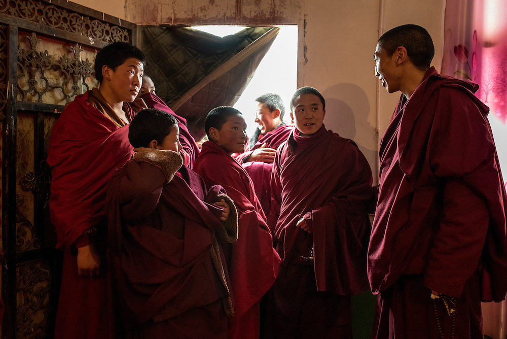 Living Buddha and environmental activist Lama Trinli Gyatso (left) talks with young monks in his monastery in Zado, Tibet (Qinghai, China).