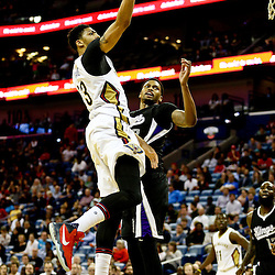 Mar 7, 2016; New Orleans, LA, USA; New Orleans Pelicans forward Anthony Davis (23) shoots over Sacramento Kings forward Rudy Gay (8) during the second half of a game at the Smoothie King Center. The Pelicans defeated the Kings 115-112. Mandatory Credit: Derick E. Hingle-USA TODAY Sports