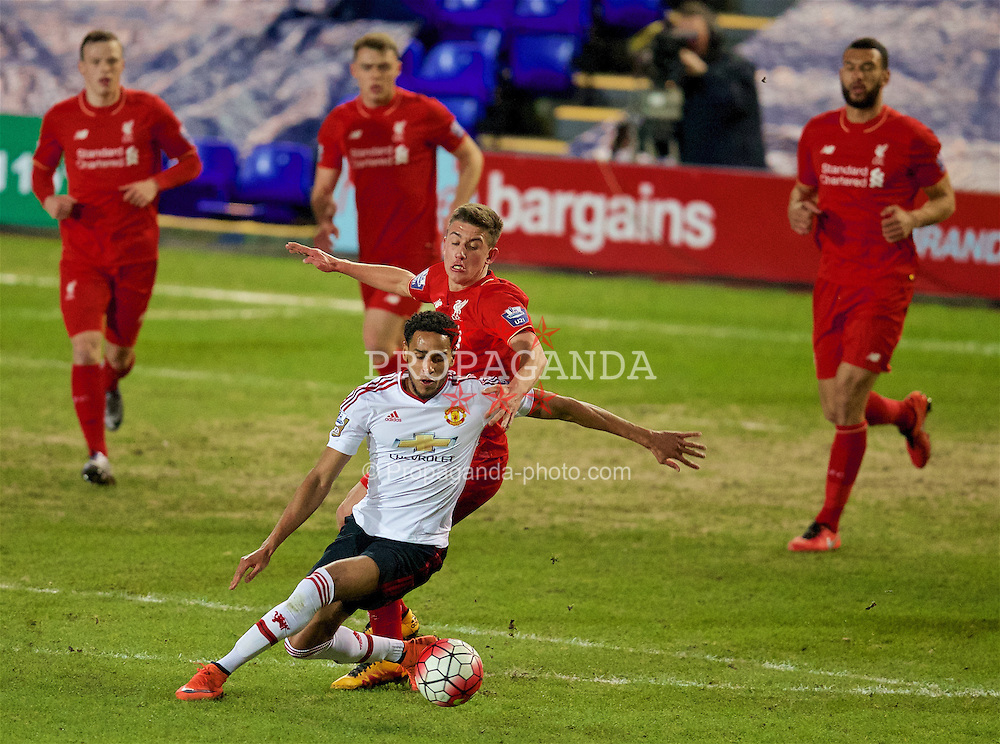 BIRKENHEAD, ENGLAND - Friday, March 11, 2016: Liverpool's Cameron Brannagan in action against Manchester United's Sadiq El-Fitouri during the Under-21 FA Premier League match at Prenton Park. (Pic by David Rawcliffe/Propaganda)