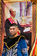 19 APRIl 2014 - BANGKOK, THAILAND: A boy guards a portrait of Rama IV, popularly known as King Mongkut, at the Rattanakosin Festival in Bangkok. Mongkut is a highly revered King in Thailand and is credited to opening Thailand to western innovations. Rattanakosin is the name of the man made island that is the heart of the old city. Bangkok was formally founded as the capital of Siam (now Thailand) on 21 April 1782 by King Rama I, founder of the Chakri Dynasty. Bhumibol Adulyadej, the current King of Thailand, is Rama IX, the ninth King of the Chakri Dynasty. The Thai Ministry of Culture organized the Rattanakosin Festival on Sanam Luang, the royal parade ground in the heart of the old part of Bangkok, to celebrate the city's 232nd anniversary.    PHOTO BY JACK KURTZ