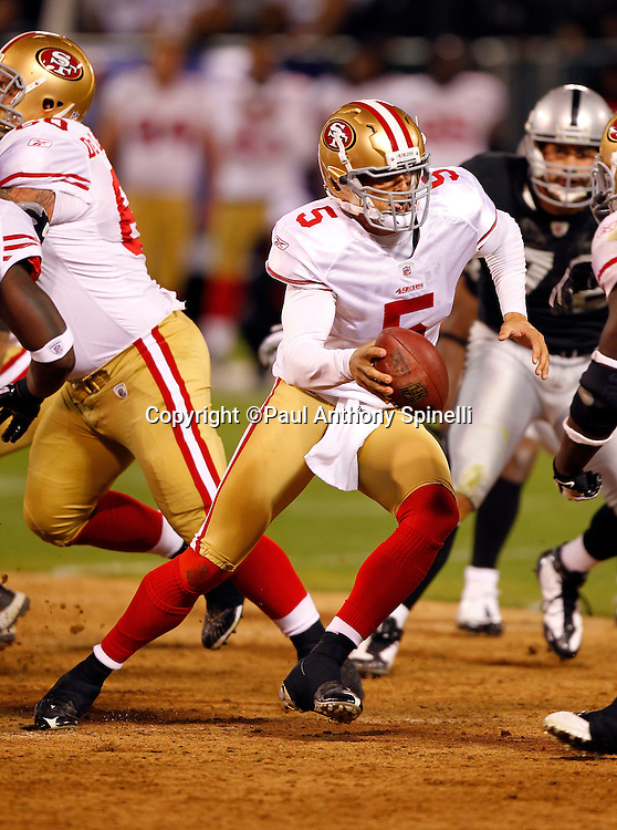 San Francisco 49ers quarterback David Carr (5) scrambles away from defensive pressure during the NFL preseason week 3 football game against the Oakland Raiders on Saturday, August 28, 2010 in Oakland, California. The 49ers won the game 28-24. (©Paul Anthony Spinelli)