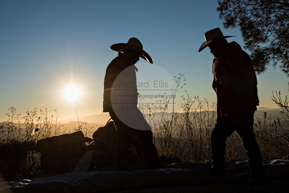 Mexican cowboys break camp at dawn on Cubilete Mountain at the start of the final day during the annual Cabalgata de Cristo Rey pilgrimage January 6, 2017 in Guanajuato, Mexico. Thousands of Mexican cowboys and horse take part in the three-day ride to the mountaintop shrine of Cristo Rey.